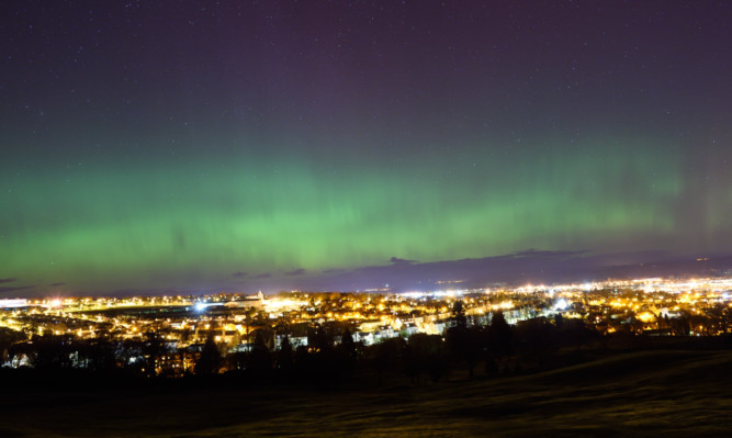 Stuart Cowper sent in this photo of the lights over Perth.