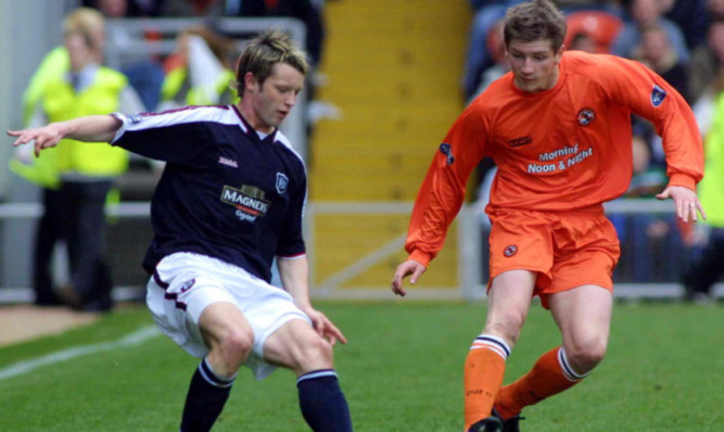 Steven Robb playing for Dundee against United's Mark Wilson.