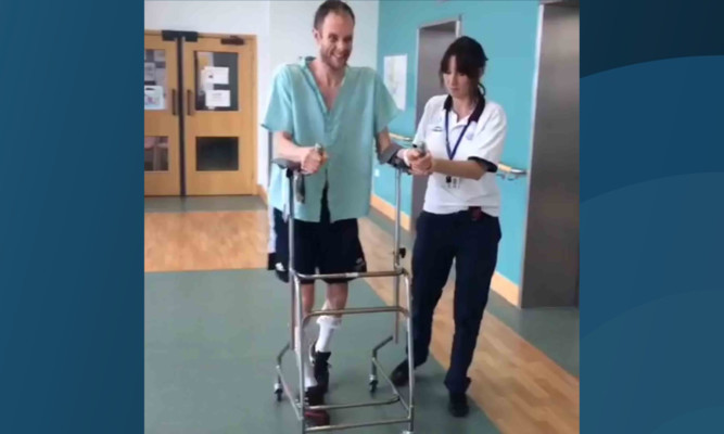 David takes his first tentative steps in hospital.