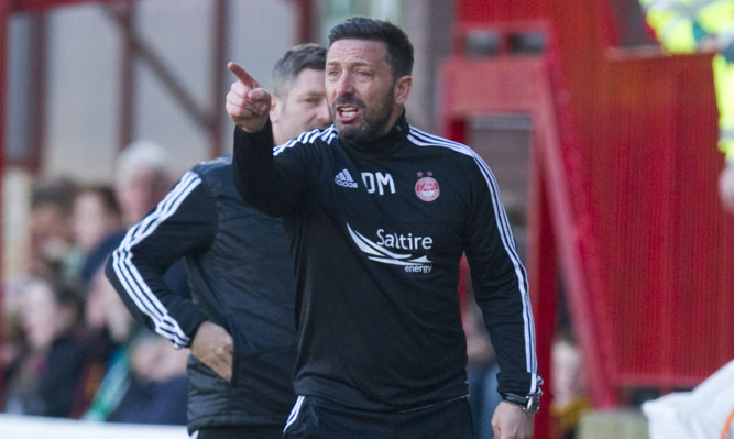 Derek Mcinnes watches his side surrender a lead.