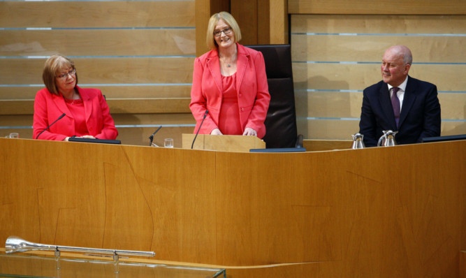 Presiding Officer Tricia Marwick (centre) says her farewell to Parliament. She is watched by deputies Elaine Smith and John Scott.