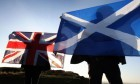 Two flags intertwined: the Union and Saltire fly in unison.