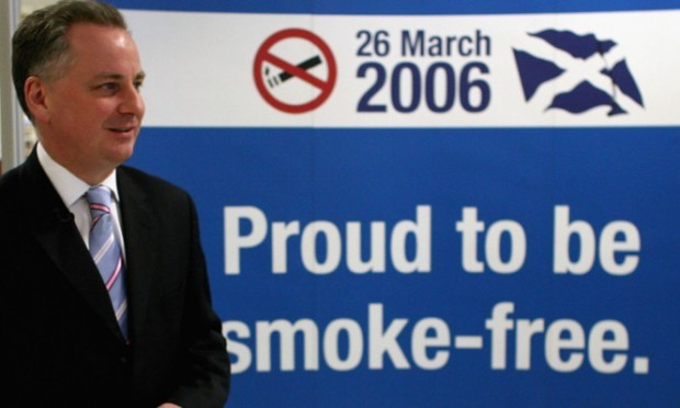 Scotland's then First Minister Jack McConnell attends a smoke free event at Edinburgh Airport on March 26, 2006.