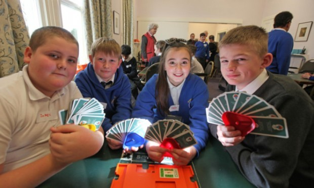 Pupils from Claypotts PS who took part in a mini bridge tournament at Dundee Bridge Club, left to right, James Getty,Cameron Wood,Chevonne Queen and Daryn Downie.