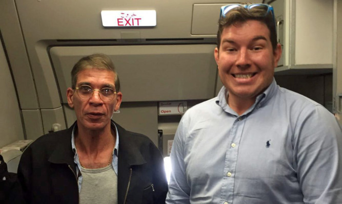Ben Innes posed with Seif Eddin Mustafa on board the plane.