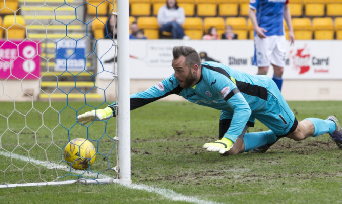 Alan Mannus fails to keep out Ryan Dow's effort.