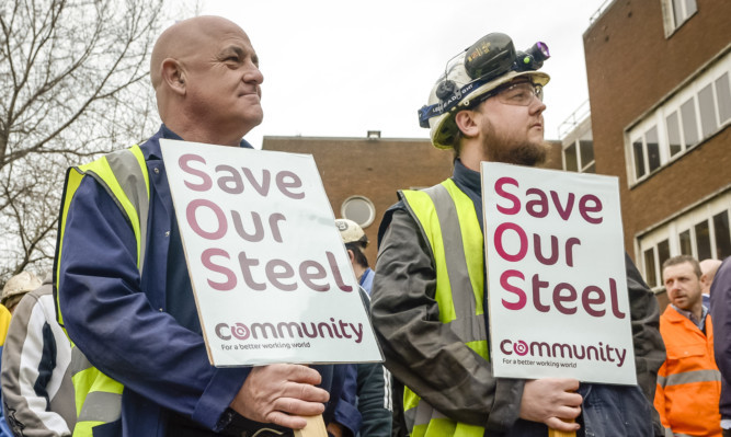 Steelworkers at the TATA plant at Port Talbot wait to meet UK Business Secretary Sajid Javid.