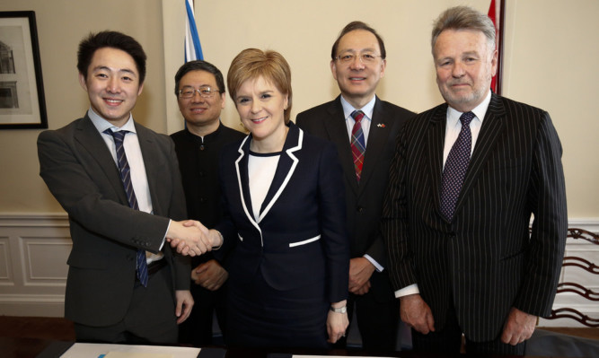 First Minister Nicola Sturgeon came under pressure to explain why a memorandum of understanding with China was not made public.