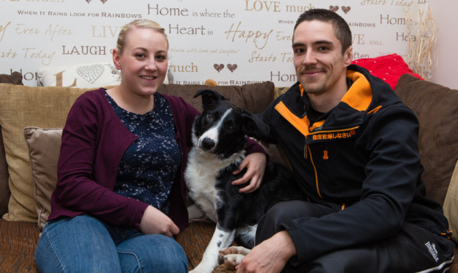 Laura Annan and Michael Thomson with Ollie.