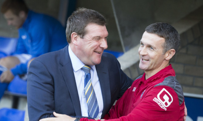 Two managers happy with their league positions - Tommy Wright and Jim McIntyre.