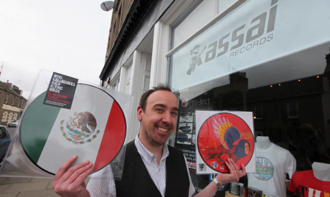 Keith Ingram with some limited edition records that will be on sale at Assai.
