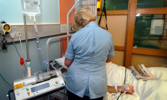 Undated file photo of a nurse treating a patient. Almost two-thirds of nurses have considered quitting their jobs in the last 12 months because they are so stressed, a survey has found. PRESS ASSOCIATION Photo. Issue date: Saturday August 31, 2013. Swingeing cuts to the numbers of nurses in the NHS have left many feeling overburdened in their work and unable to give the care they want, the Daily Mirror said. See PA story HEALTH Nurses. Photo credit should read: David Jones/PA Wire