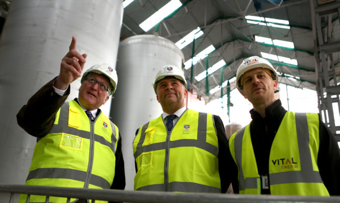 Fergus Ewing (left) being shown around by Derek Watson and Vital construction manager David Raley.
