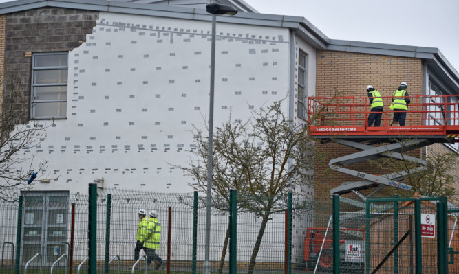 Workmen carry out repairs at Oxgangs Primary School.