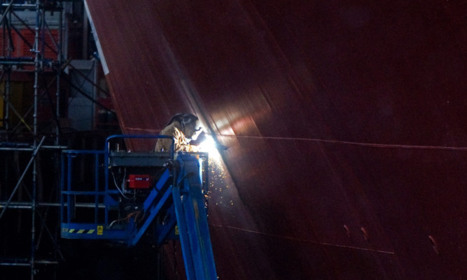 Welding work being carried out on the Queen Elizabeth aircraft carrier at Babcock's site in Rosyth.