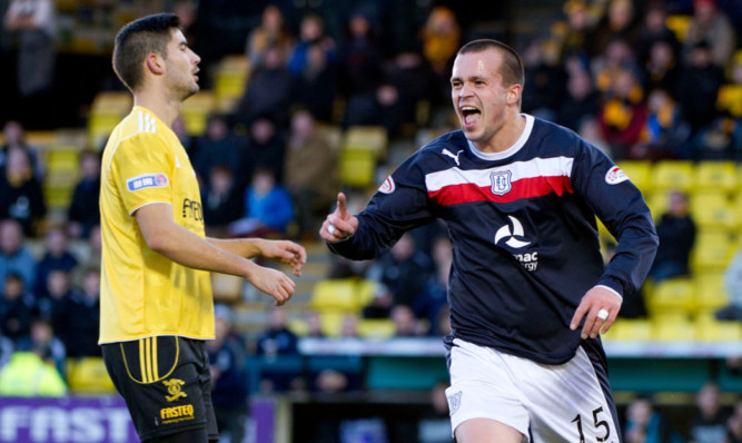 Striker Steven Milne has been released by Dundee.