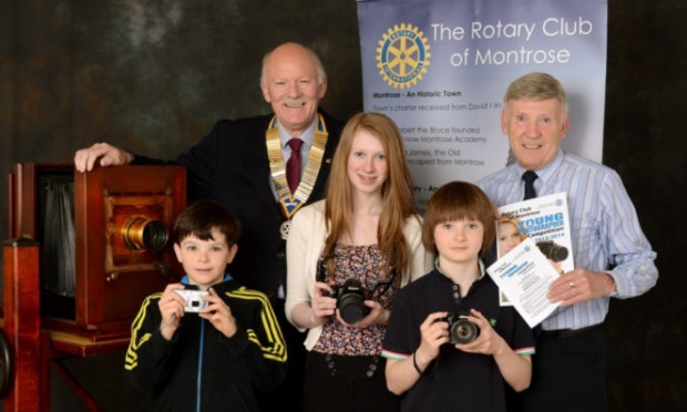 Elliot Scott, Kayleigh Ligertwood and Dean Scott with, at back, Montrose Rotary president Chris Hardy and Neil Werninck.