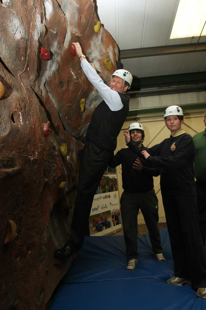 Fordell Firs Scout HQ, near Dunfermline.        Justice Secretary Kenny MacAskill MSP announces youth funding.     Pic:       Kenny MacAskill tries the climbing wall, while Craig Hopkins and Susan MacFarlane prepare for the worst!.
