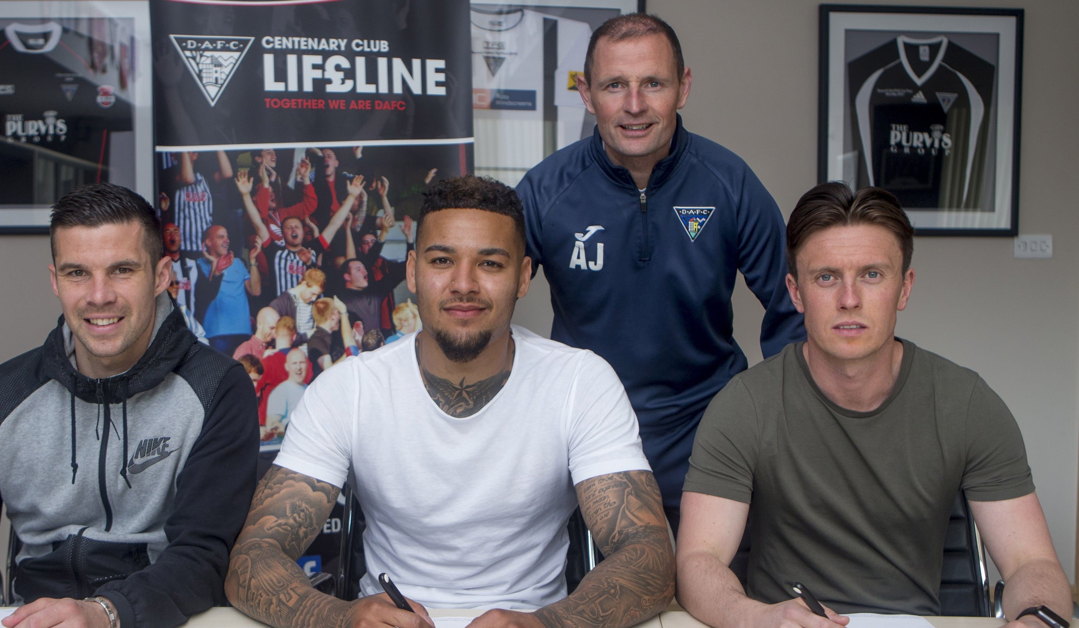 Dunfermline manager Allan Johnston with from left to right, Jason Talbot, Ben Richards-Everton and Joe Cardle.