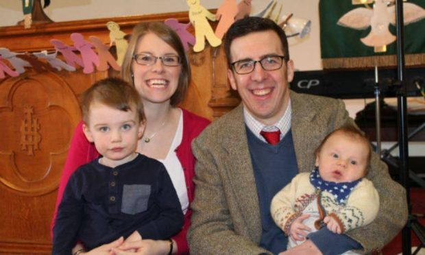 The Rev Stuart Irvin, his wife Lynne and their two young sons.