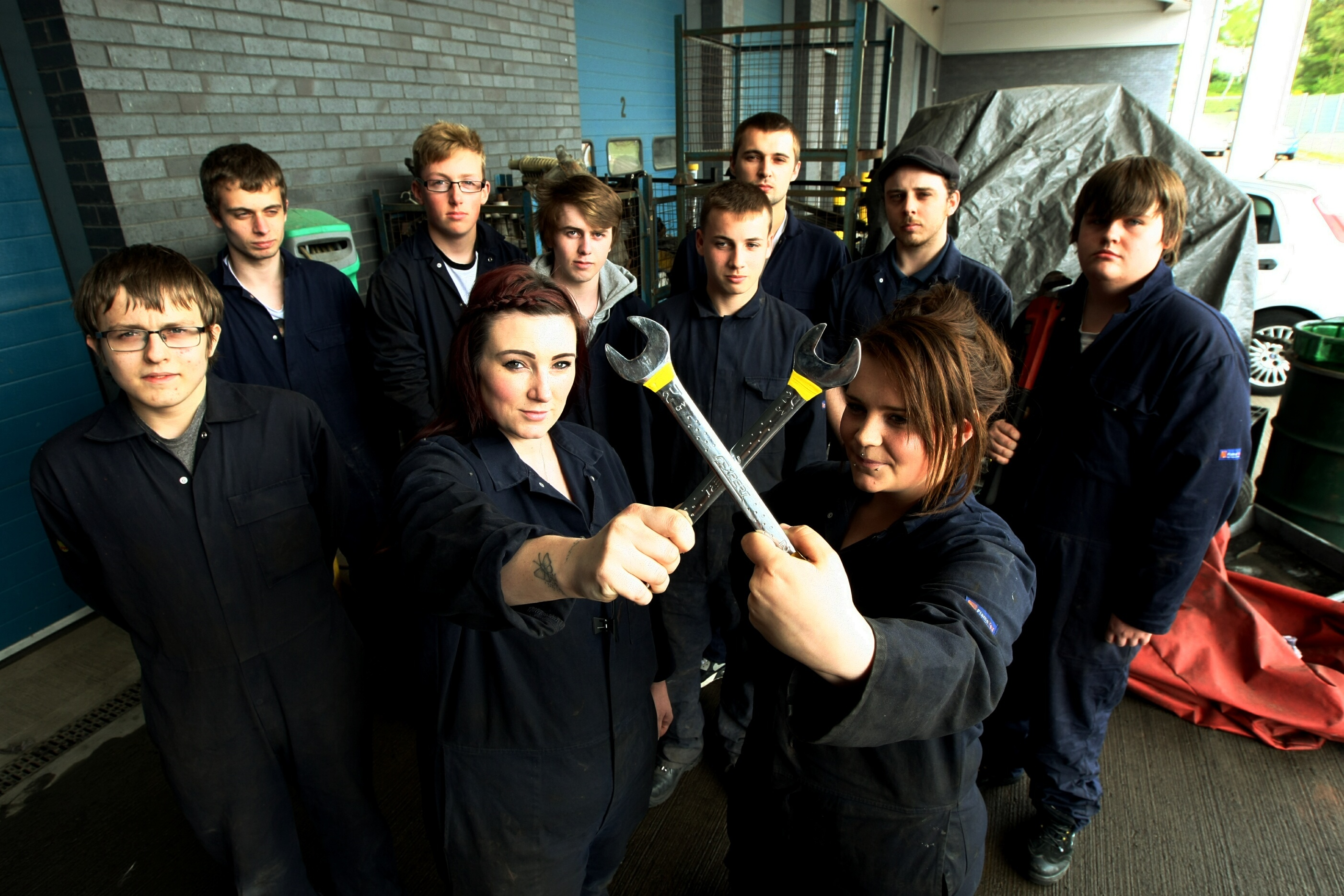 Some of the automotive maintenance students who have signed the petition to save the course.