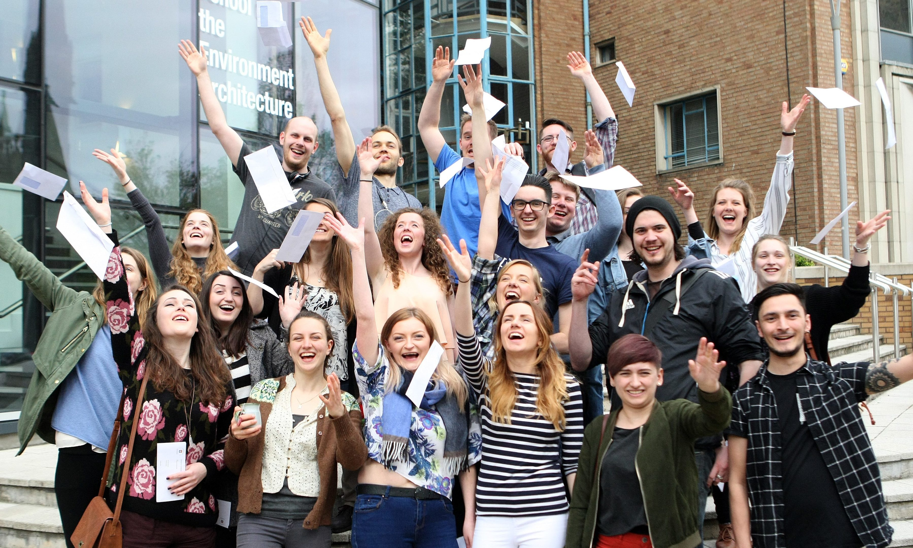 Students celebrating opening their results.