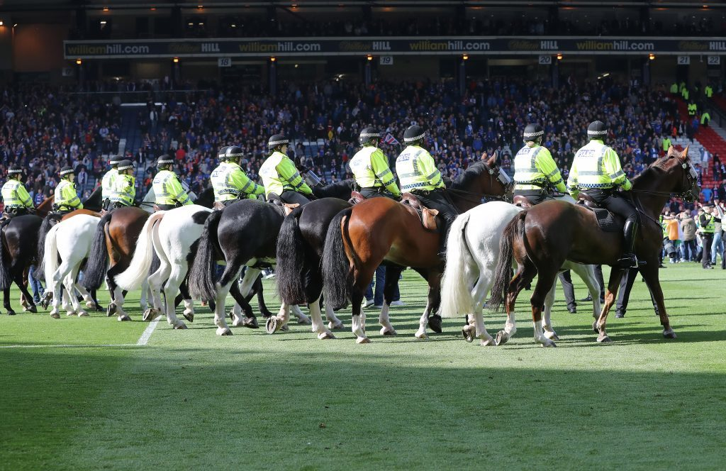 GLASGOW, SCOTLAND - MAY 21:  Mounted Police arrive as Hibs fans invade the pitch at the final whistle after winning the Scottish Cup Final between Rangers and Hibernian at Hampden Park on May 21, 2016 in Glasgow, Scotland. (Photo by Ian MacNicol/Getty)