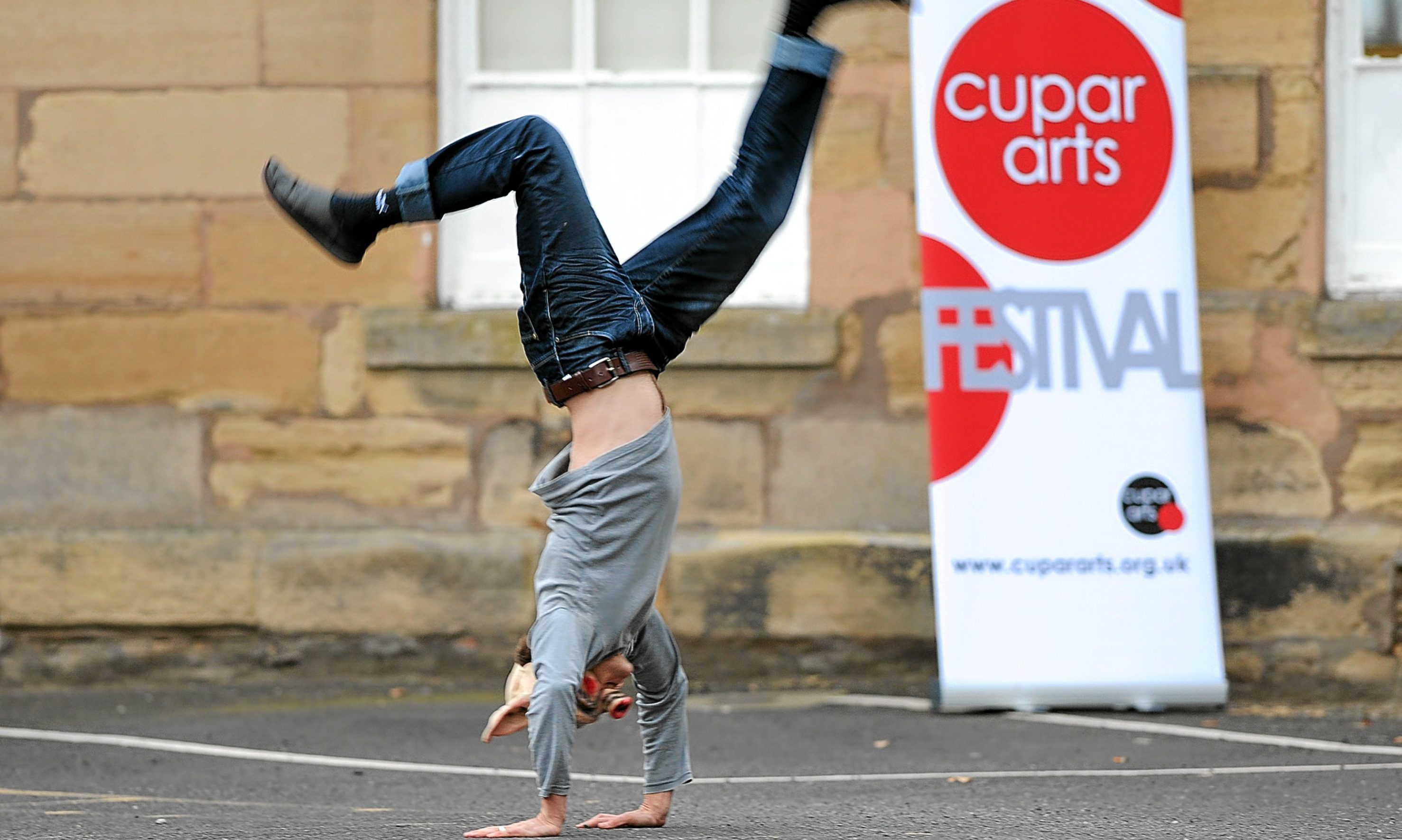 Outside the Cupar Arts Festival HQ is artist Anthony Schrag.