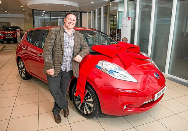 Neil Swanson and the Nissan LEAF he won
