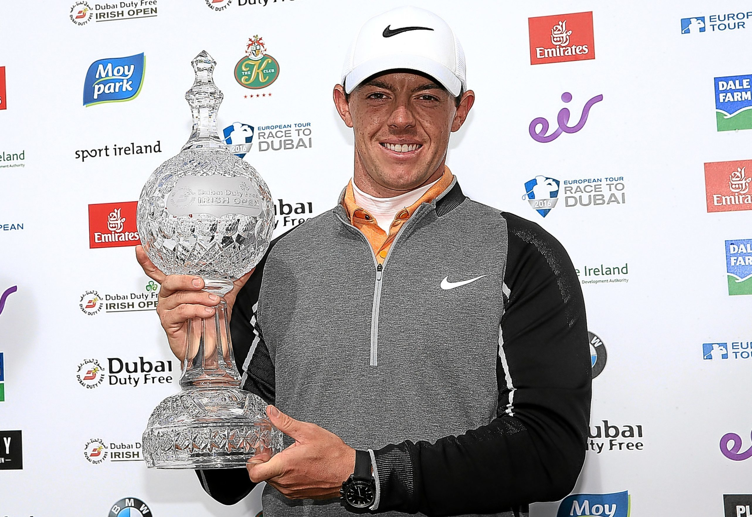 Rory McIlroy poses with the trophy.