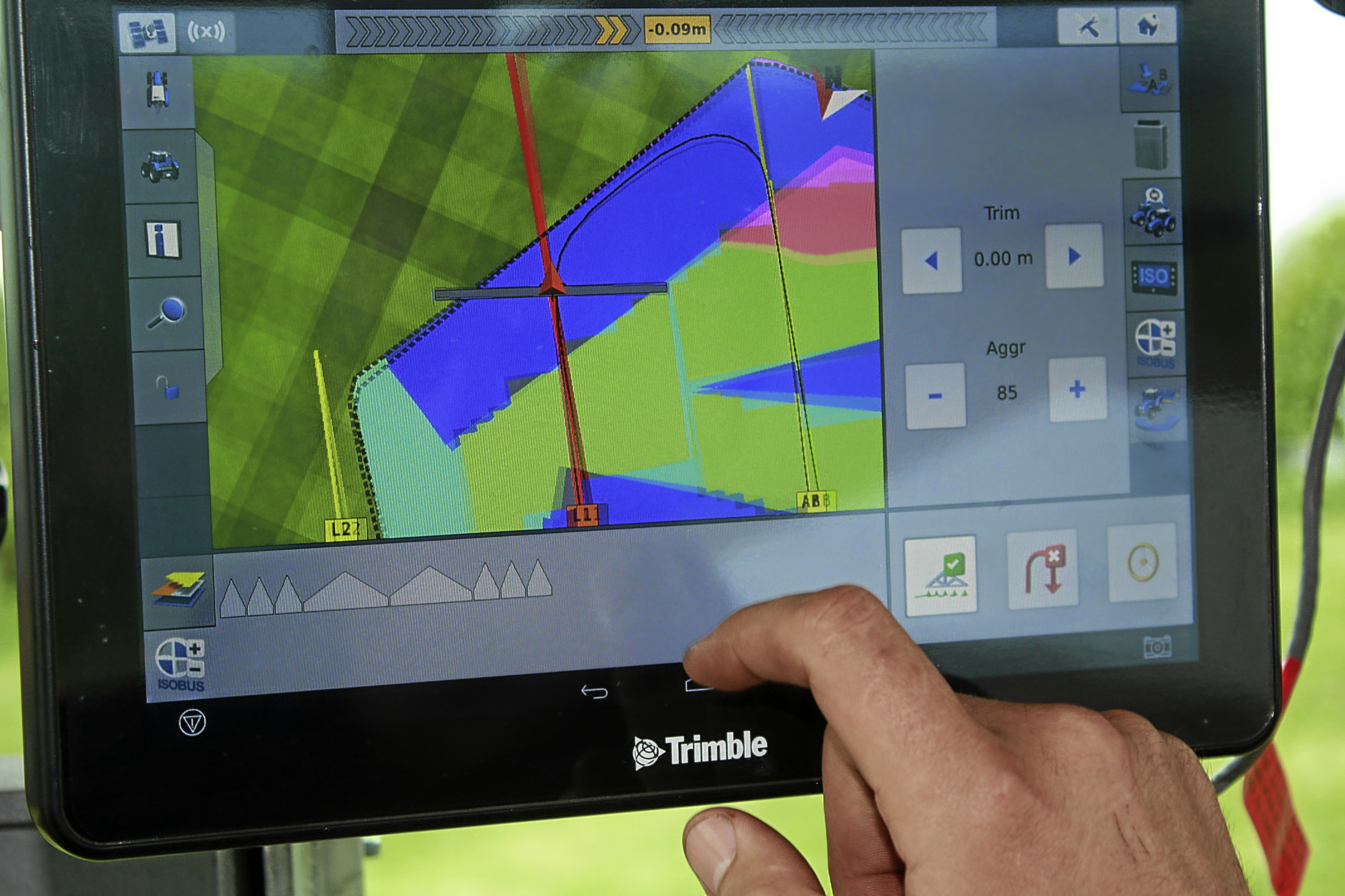 The in-cab monitor in a tractor fitted with autosteer, and variable rate fertiliser spreading technology.