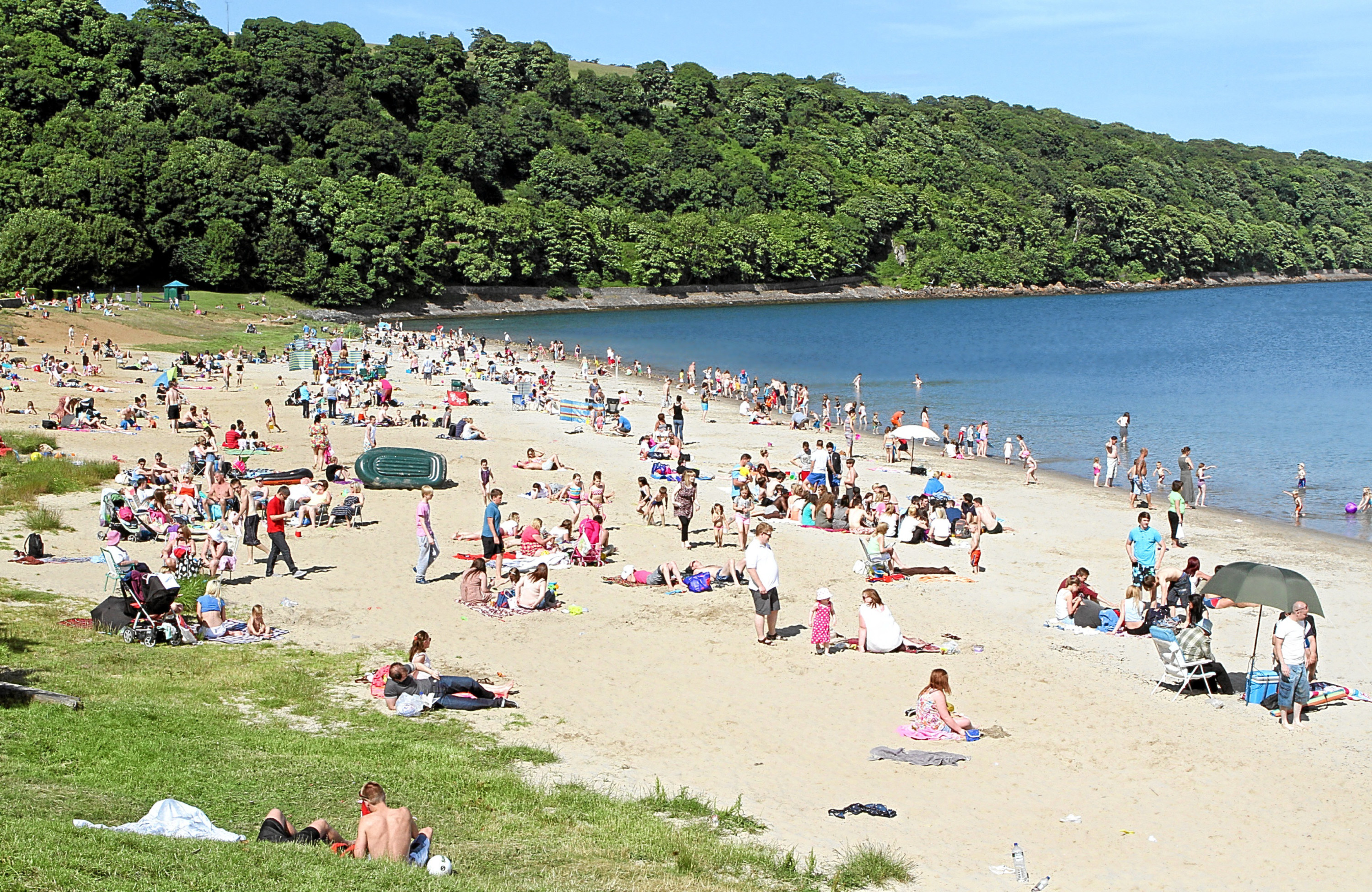 Silver Sands is busy with families on a sunny day but is often used by underage drinkers in the evenings
