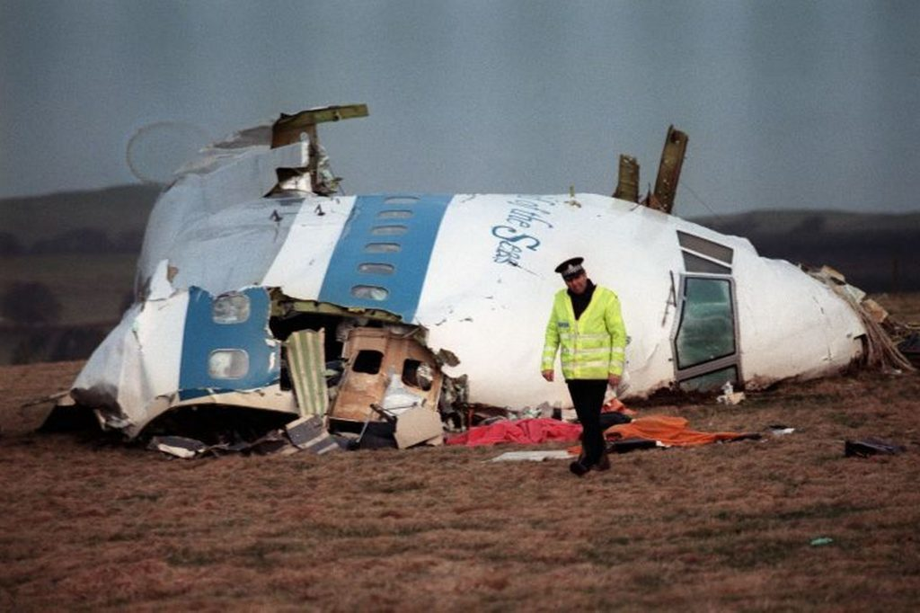 A-policeman-walking-away-from-the-damaged-cockpit-of-the-747-Pan-Am-airliner-that-exploded-and-crashed-over-Lockerbie.jpg