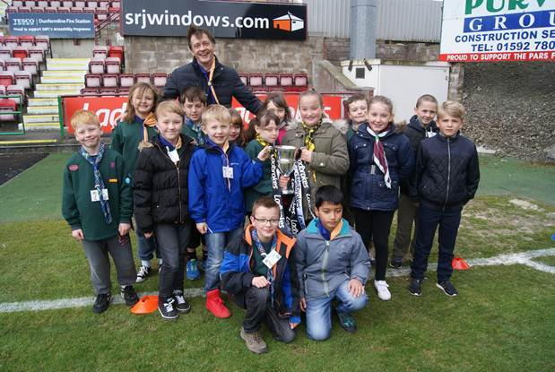 Cub scouts hold the league cup at the Dunfermline event