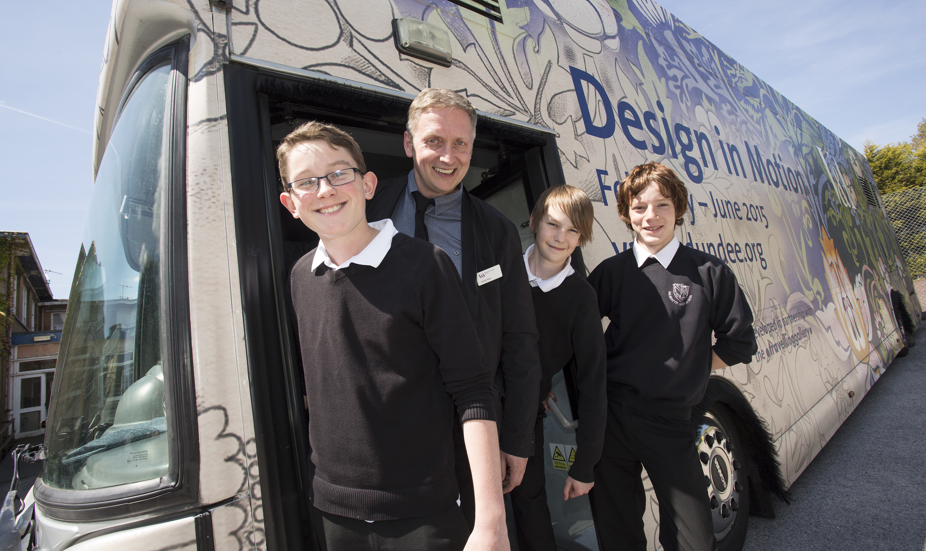 Sandy Hope with pupils from Dalbeattie High School on the Design in Motion gallery bus.