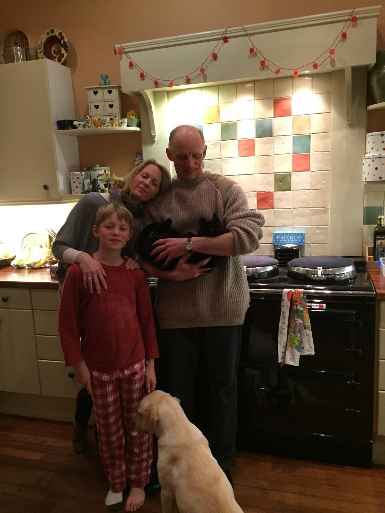 Elizabeth with husband Guy and younger son Bruce, and family pets