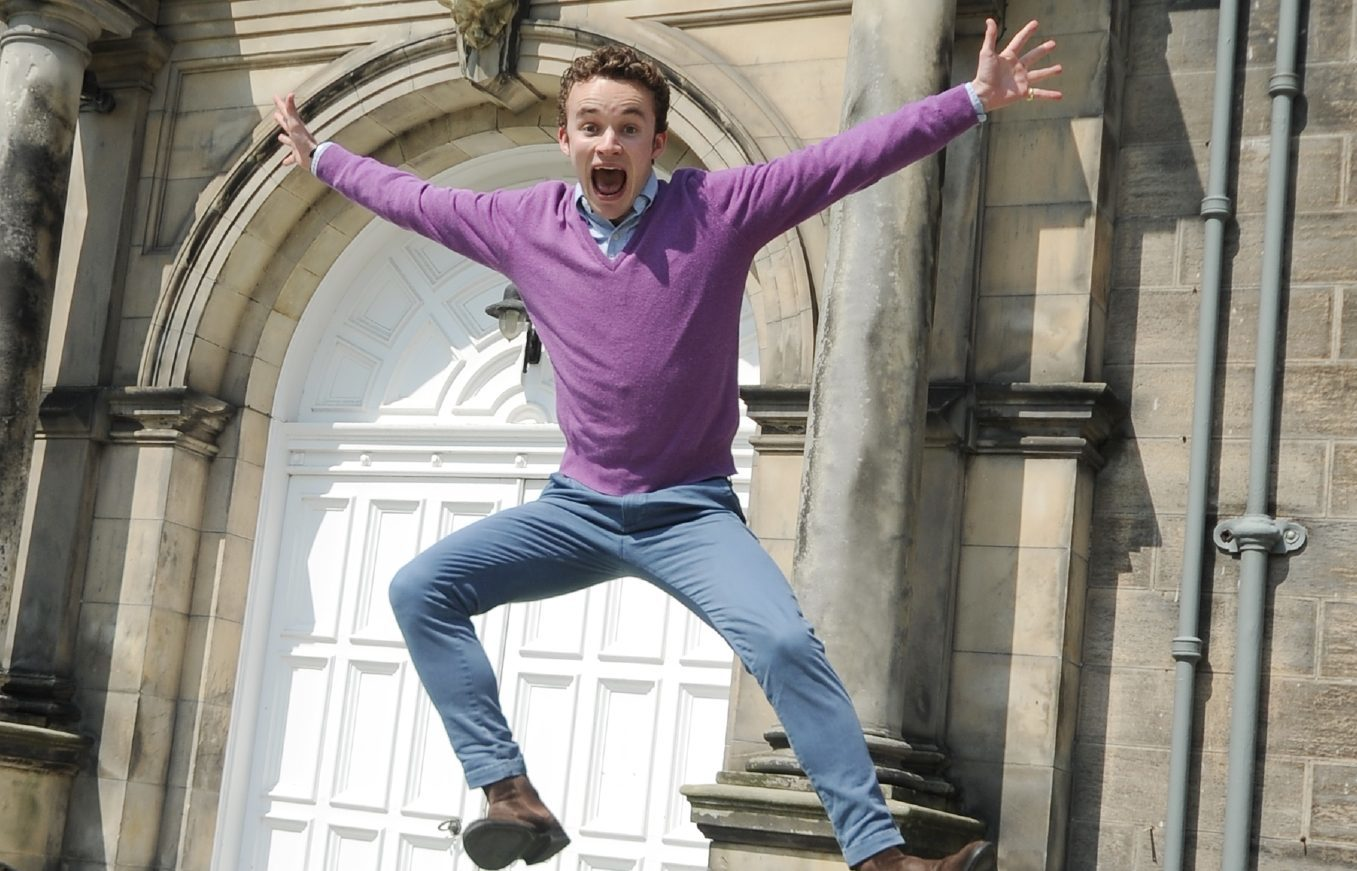 Fashion show director Oscar Macdonald jumps for joy at the £30,000 raised for SANE and its black dog campaign