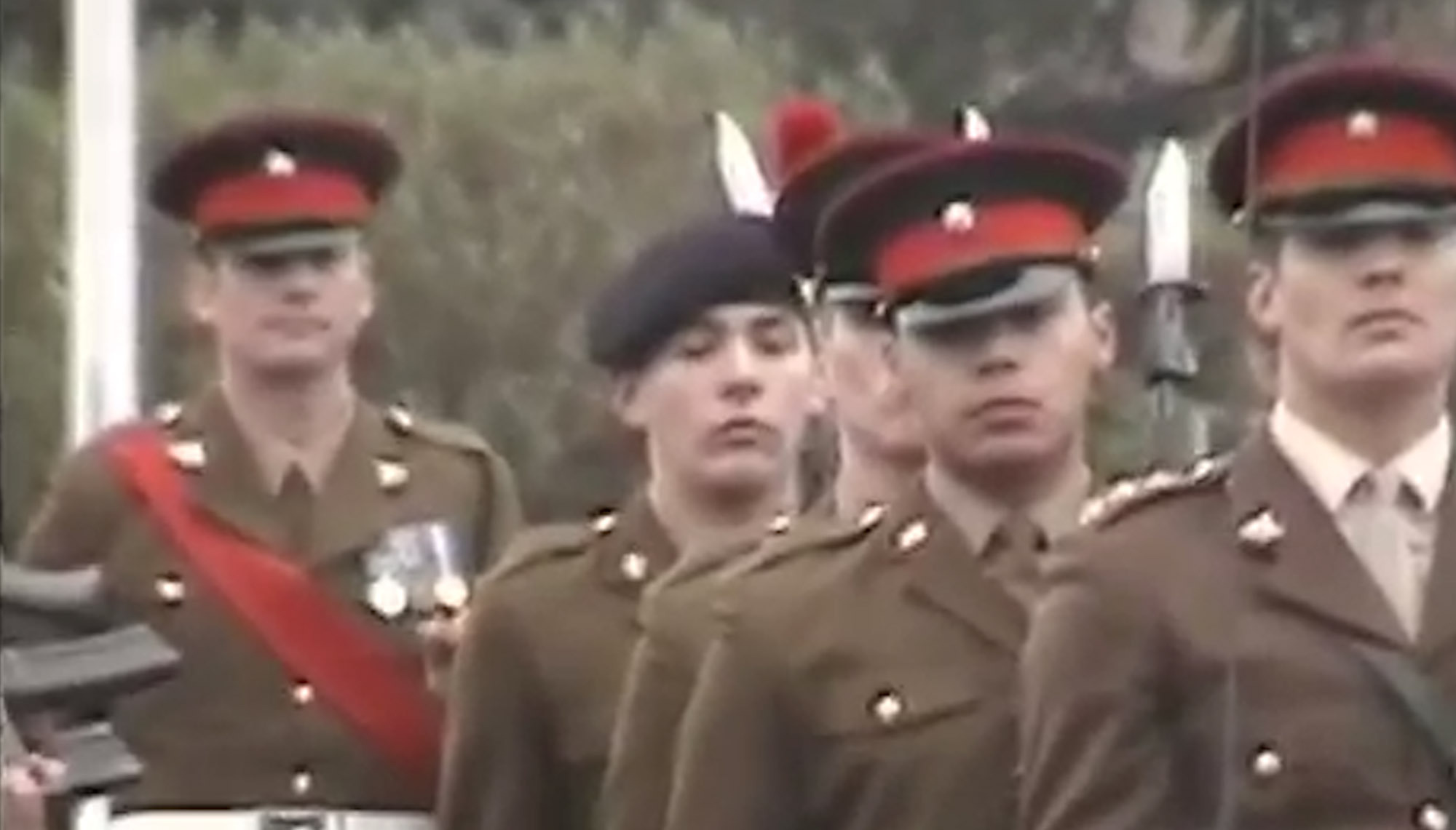 Family video of Fusilier Lee Rigby (centre).