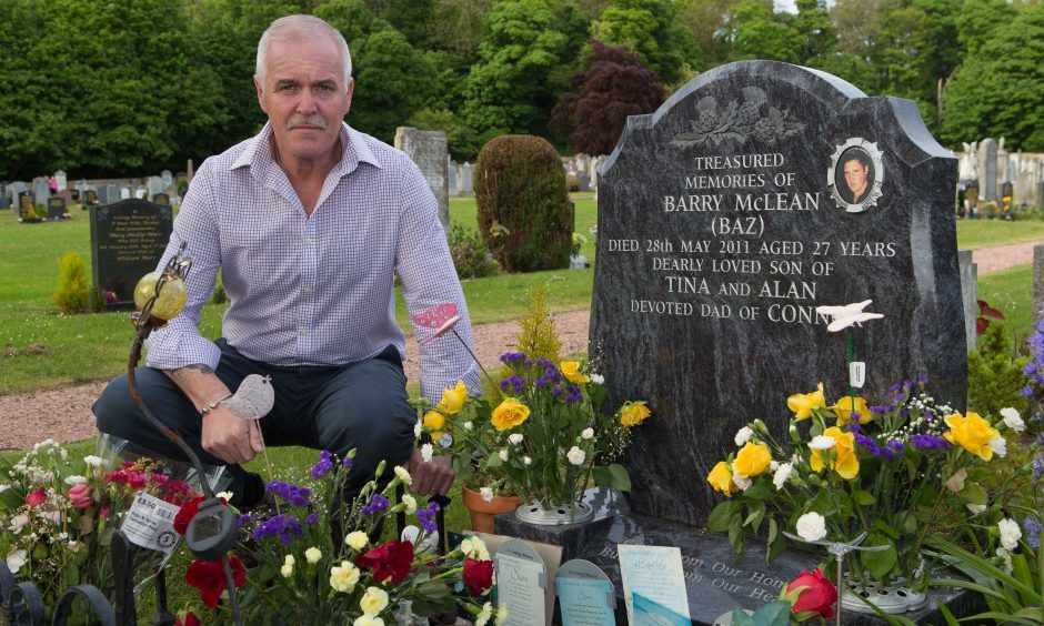 Alan McLean at the grave of his son Barry McLean