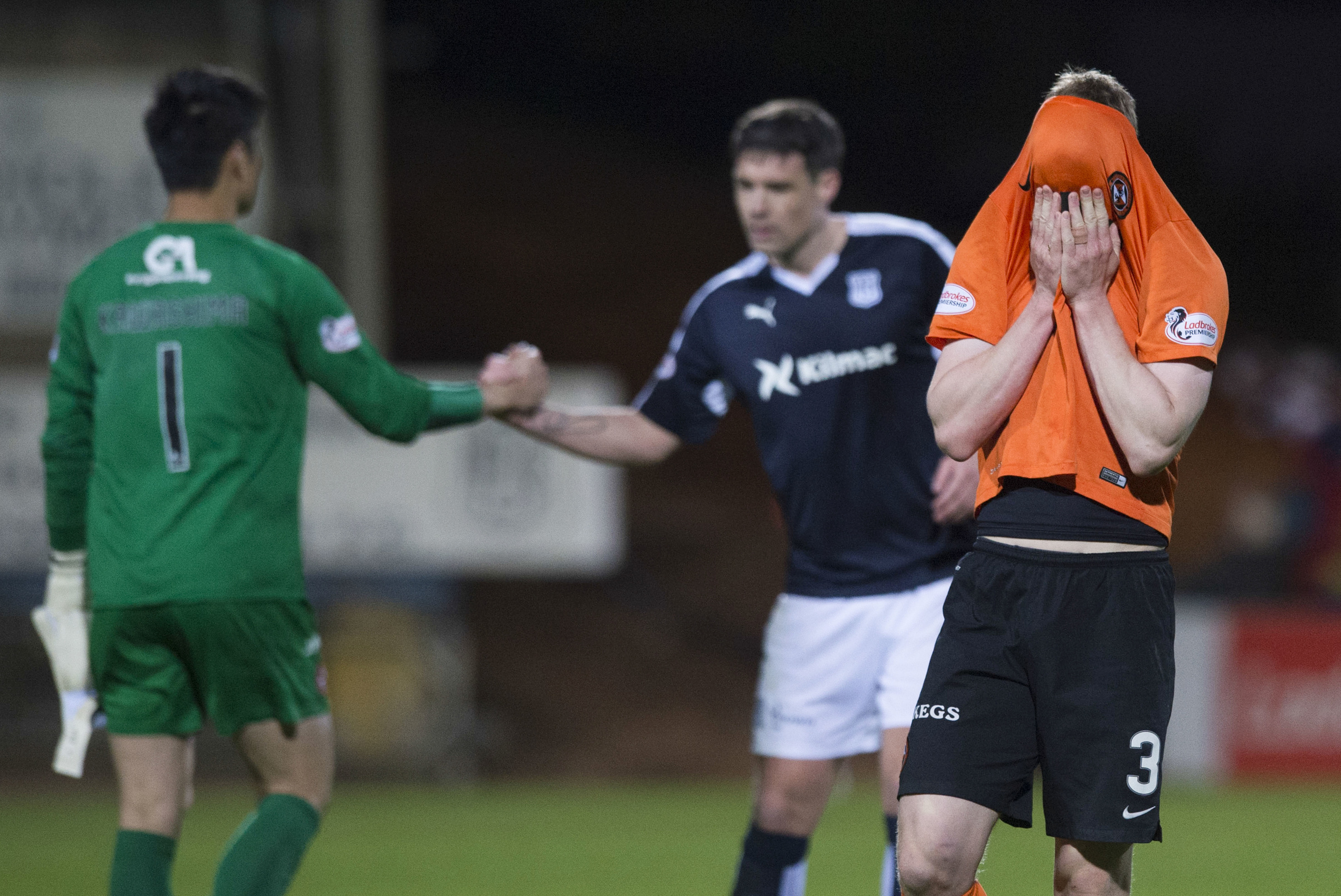 Dundee United's Paul Dixon is devastated at the final whistle.