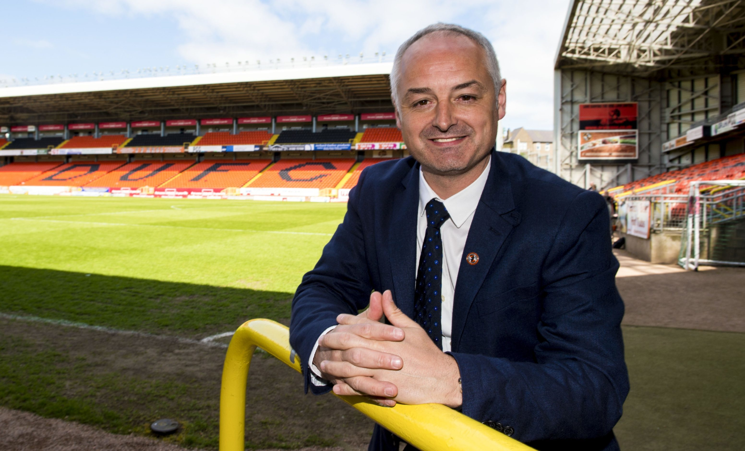 Ray McKinnon is all smiles at Tannadice.