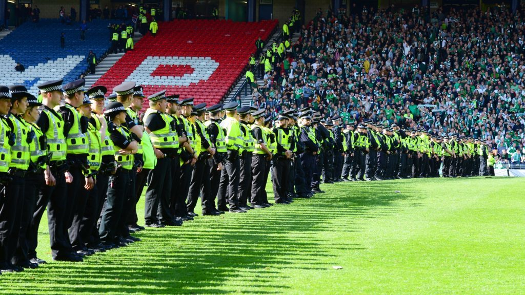 21/05/16 WILLIAM HILL SCOTTISH CUP FINAL RANGERS v HIBERNIAN HAMPDEN - GLASGOW Police line up across the pitch to push back the Hibernian supporters.