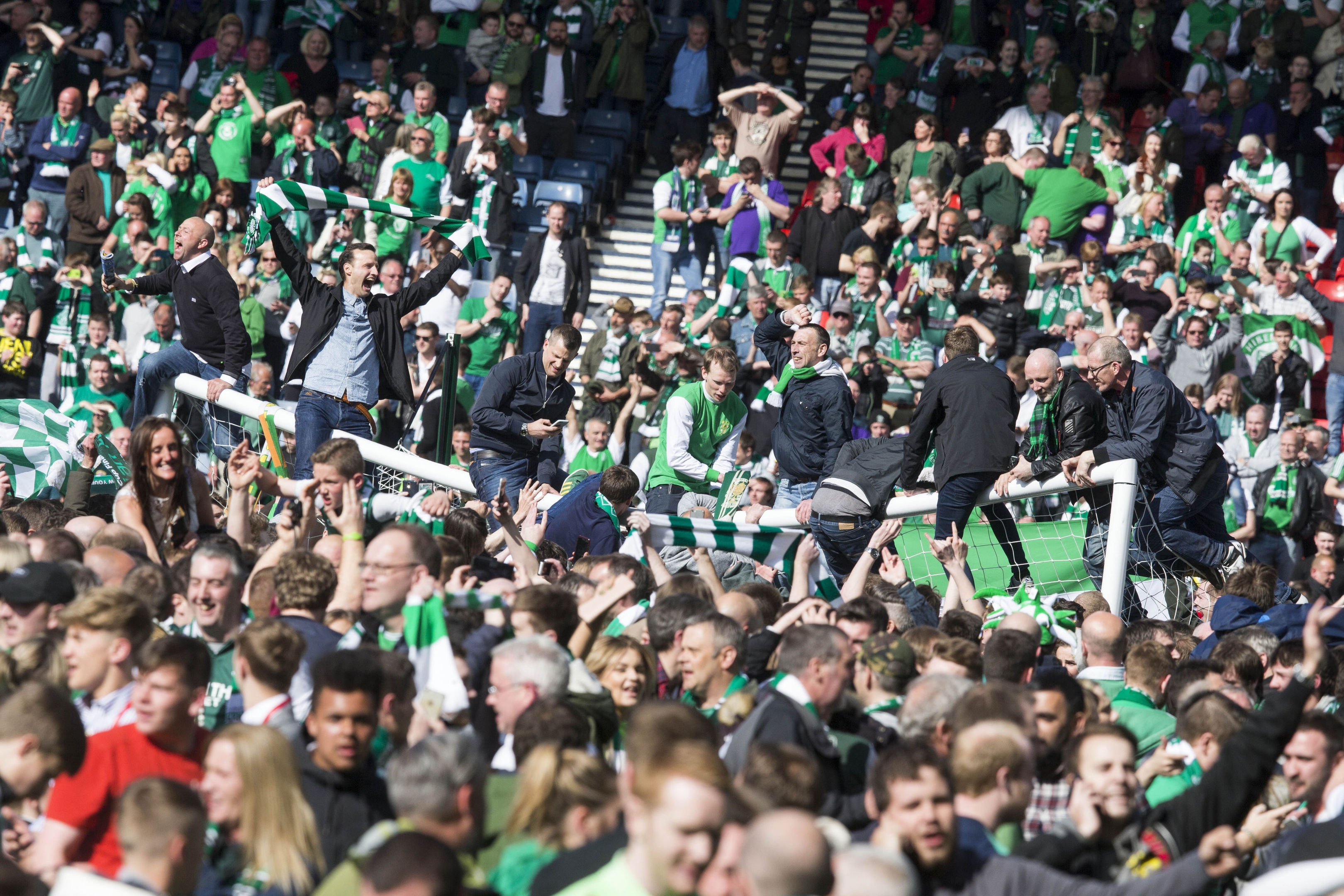Fans invade the pitch after the William Hill Scottish Cup Final.