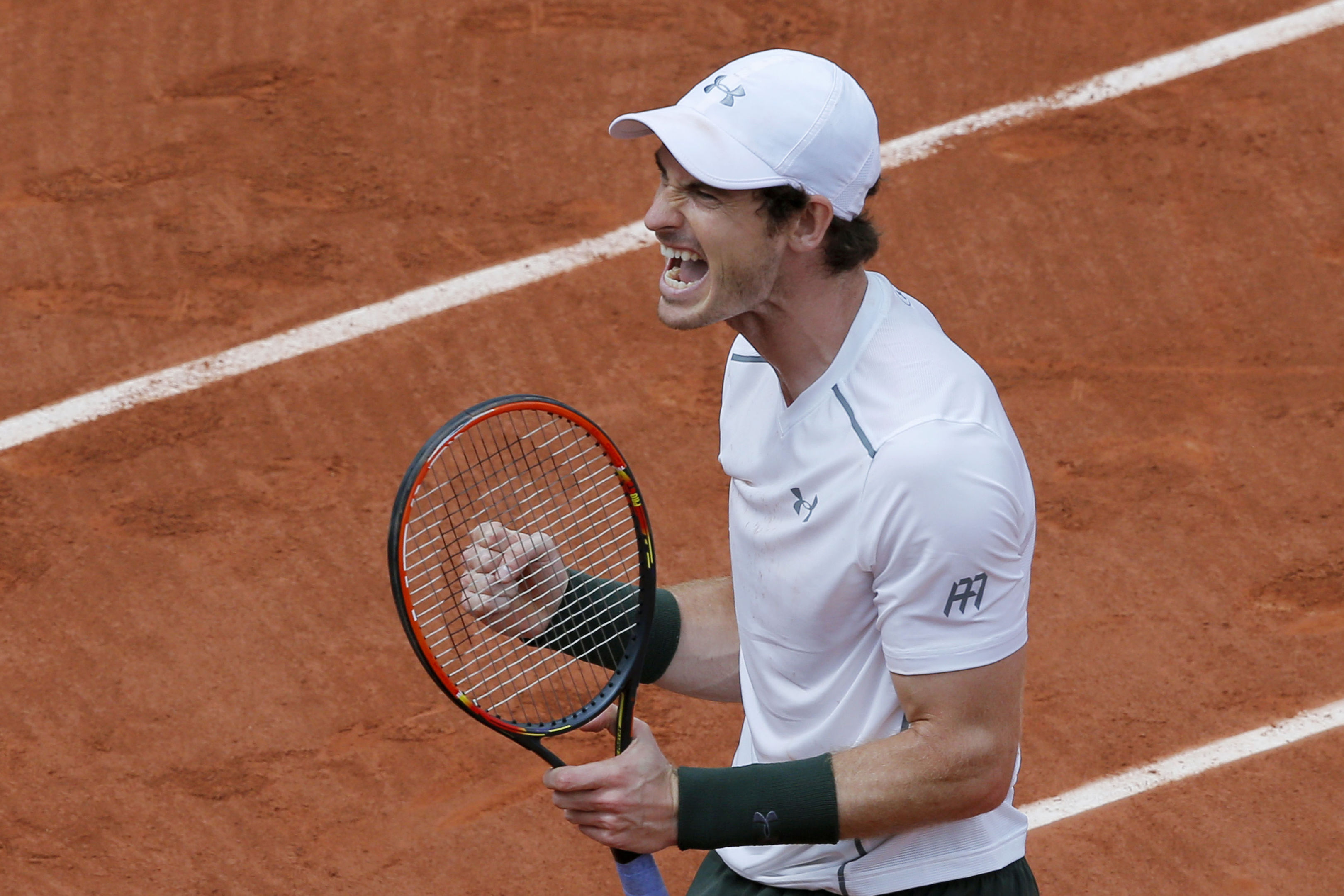 Andy Murray celebrates reaching the fourth round.