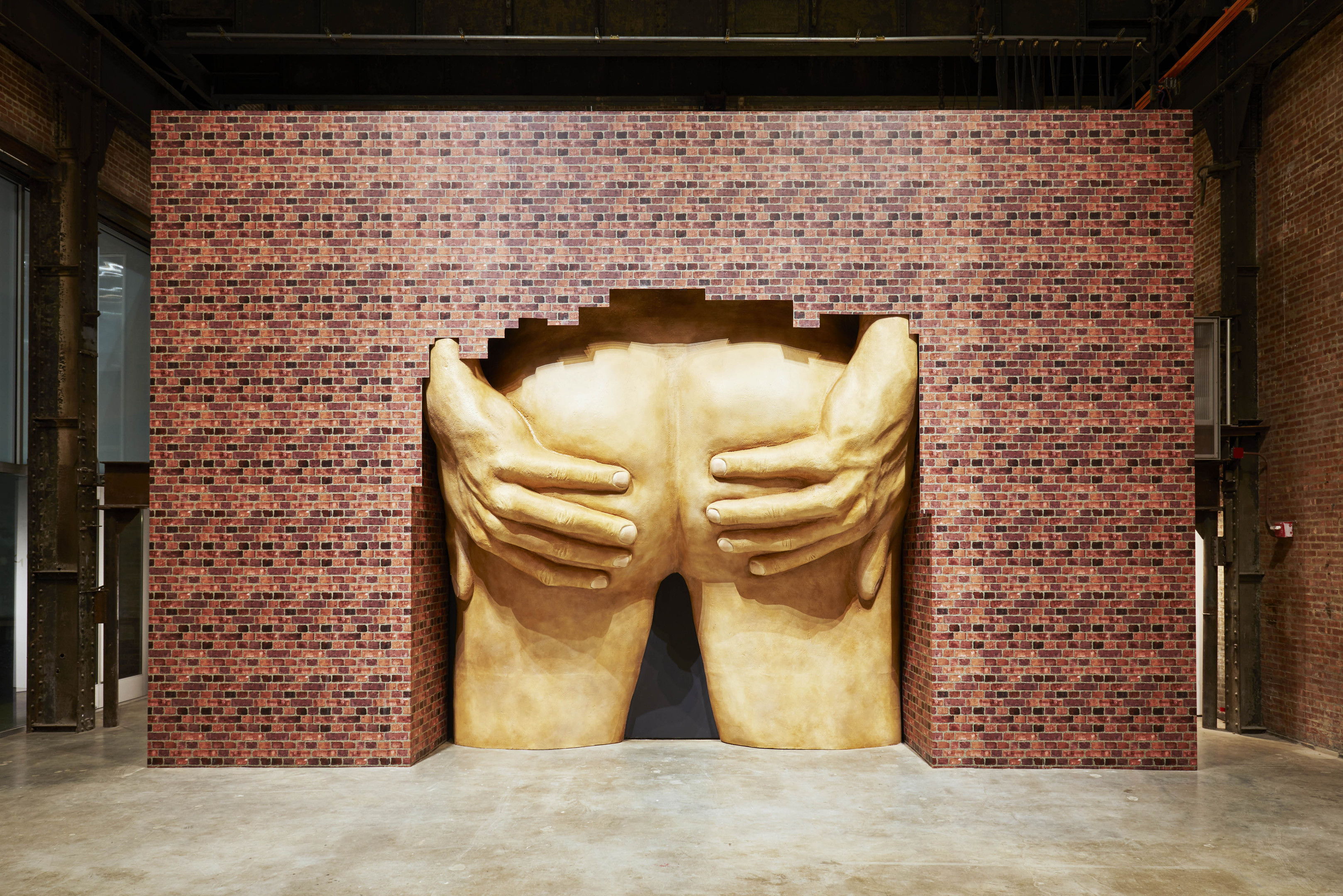Anthea Hamilton's piece featuring a large set of buttocks apparently bursting out from behind a wall.