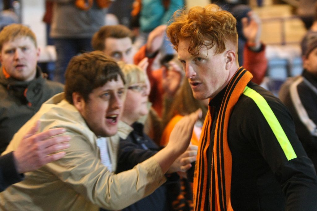 Dundee Uniteds Simon Murray is consoled by fans after being relegated from the Premiership at Dens
