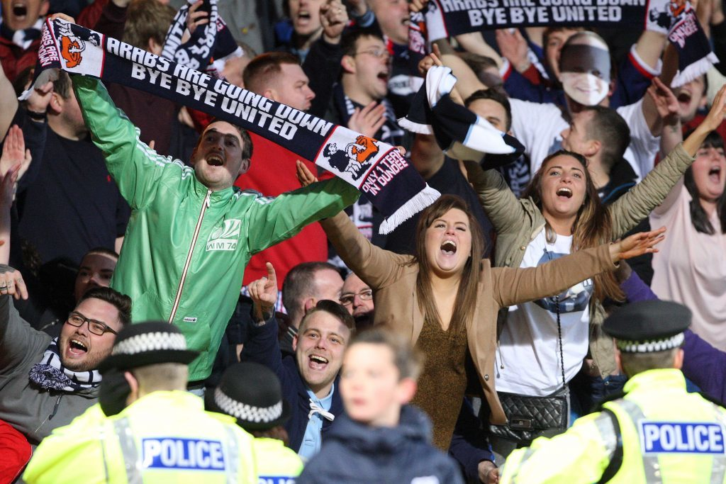 Dundee fans celebrate victory over city rivals United at Dens Park on May 2 - a result that confirmed the Tannadice clubs relegation