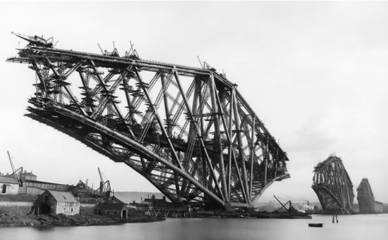 The Forth Rail Bridge under construction. It opened in the 1890.