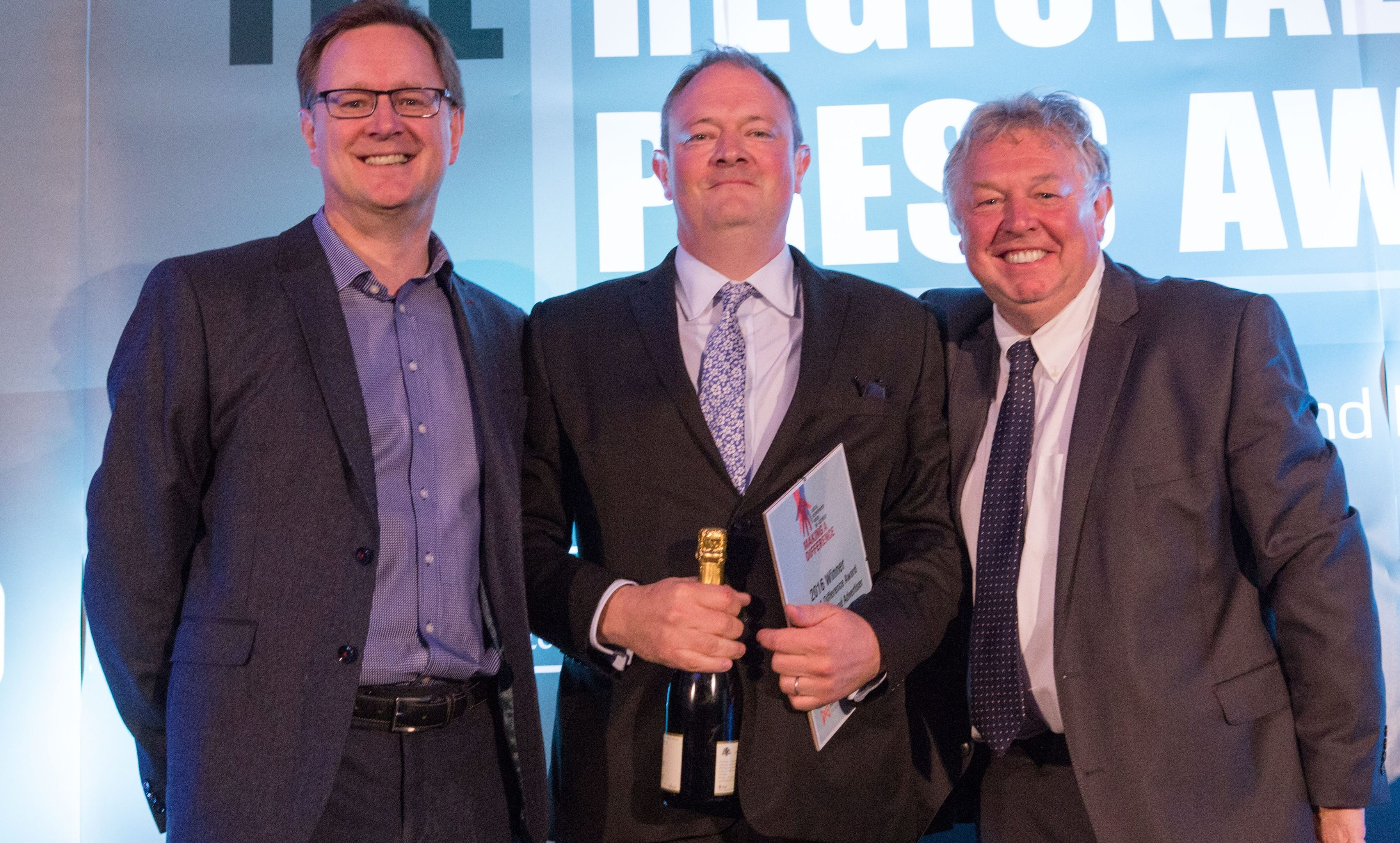 Courier editor Richard Neville accepting the making A Difference Award from Ashley Highfield, left, and host Nick Ferrari, right.