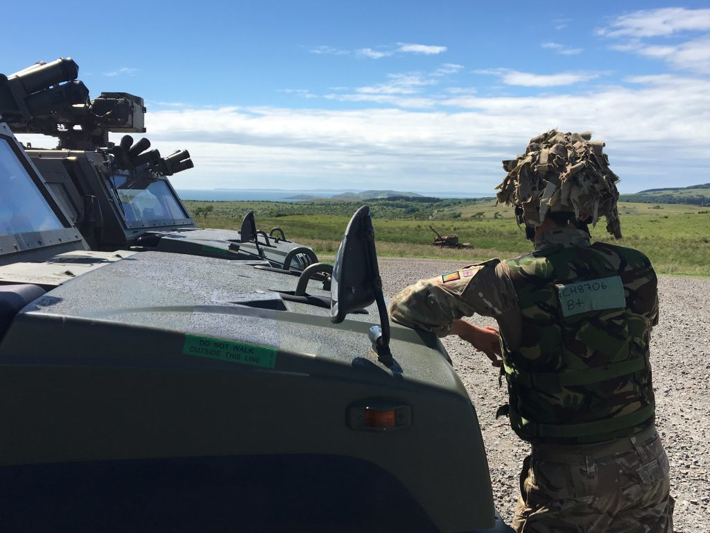 Keeping a look out from a Panther command vehicle